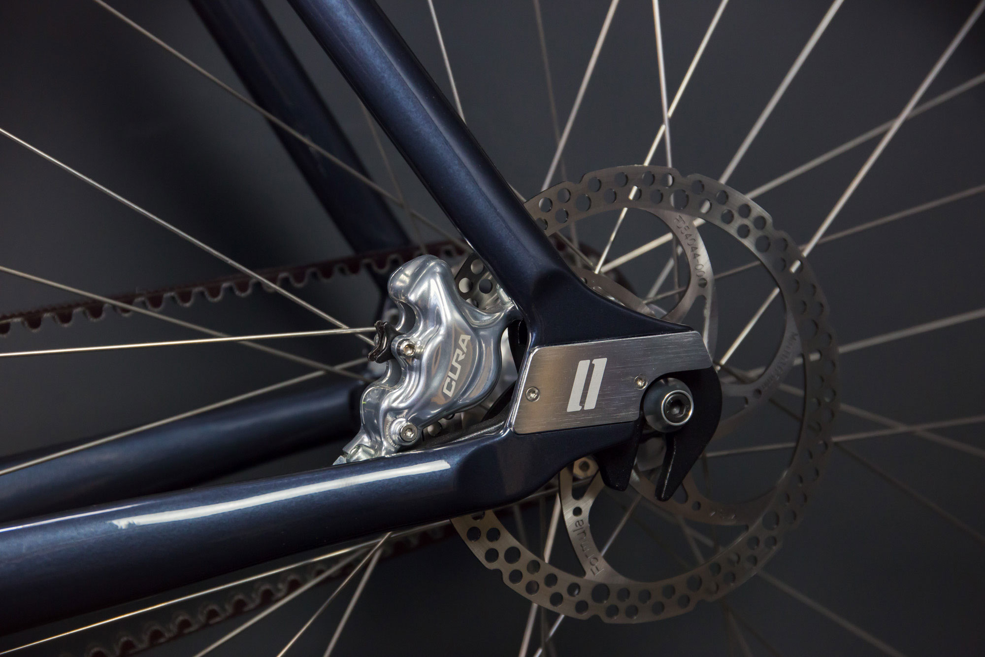 Slider belt tensioning system on our Wilhelm, including the integration of a disc brake caliper